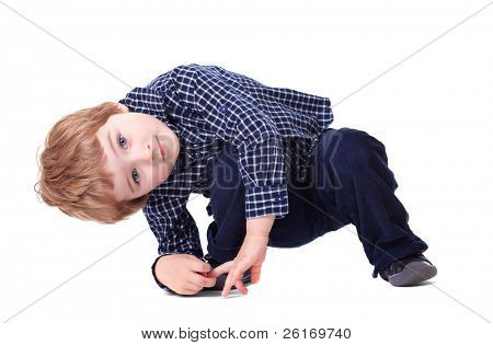 Curious 3 year old makes funny pose, looking from underneath, isolated on white