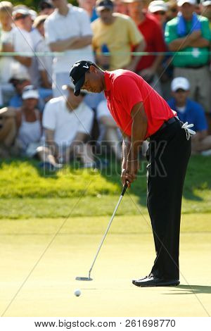 BETHESDA, MD - JULY 1, 2012: Tiger Woods putts the green during the final round of the AT&T National at Congressional Country Club.