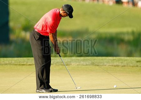 BETHESDA, MD-JULY 1, 2012: Tiger Woods putts the 18th green during the final round of the AT&T National at Congressional Country Club.