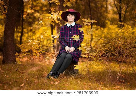60 Year Old Woman In Red Hat Dreams In Gold Autumn Par