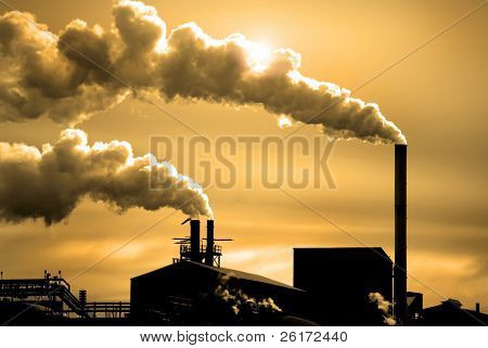 Detail of pollution coming from factory smoke stacks