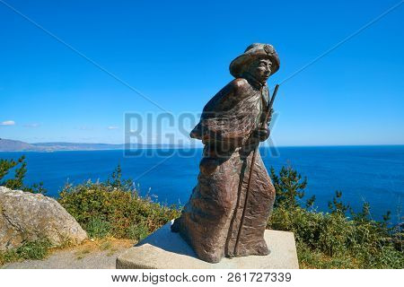 FINISTERRE, GALICIA, SPAIN - JUNE 4: Finisterre also Fisterra is the end of Saint James Way of Spain on June 4 2017. The statue represents a pilgrim in Camino de Santiago track.