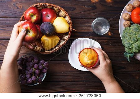 Obesity prevention, conscious eating, nutrition choices, mindfulness and healthy lifestyle. Woman choosing between junk sweet food and fruits poster