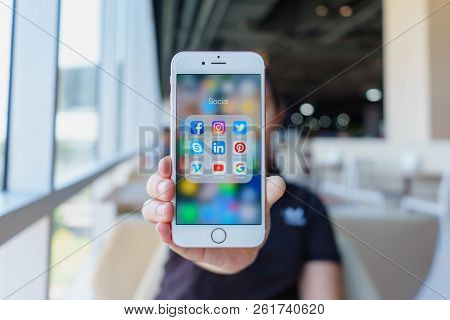 Chiang Mai, Thailand - Feb 22,2018: Woman Holding Apple Iphone 6s Rose Gold With Icons Of Social Med