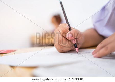 Education Students Testing Exam With Pencil Drawing Selected Multiple-choice Quizzes Or Testing Exam