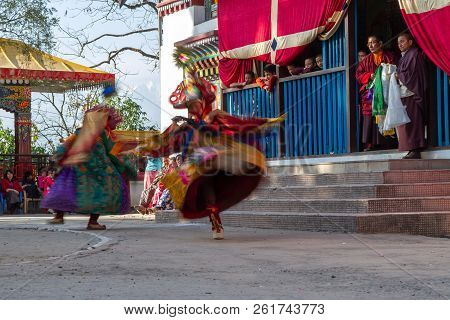 Unidentified Monks Perform A Religious Masked And Costumed Mystery Dance Of Tibetan Buddhism During