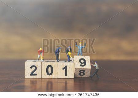 Miniature Worker Team Building Wooden Block Number 2019 On Wooden Background