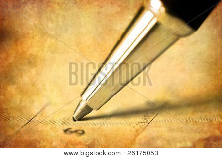 Pen writing on antique check an amount of money
