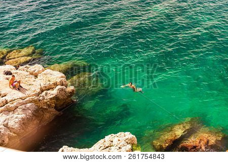 Nice, France - 2018. Young Boys Swimming Close To The Rock In Nice, France.