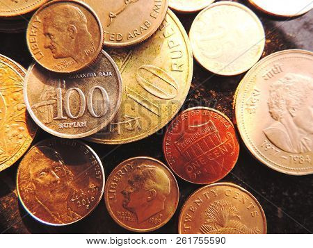 Closeup Of Bunch Of Coins From Various Nationalities Including Singapore, Us 1, 5 Cents & 1 Dime Wit