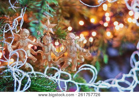 Christmas branch adorned with three golden cherubs poster