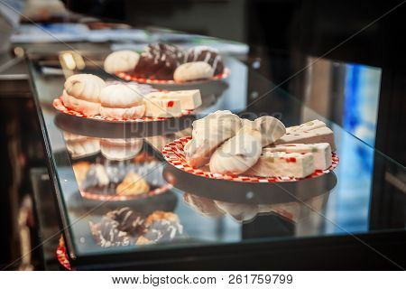 Fresh Cakes On The Dishes In The Storefront