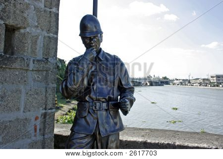 A statue of a spanish soldier in the park poster