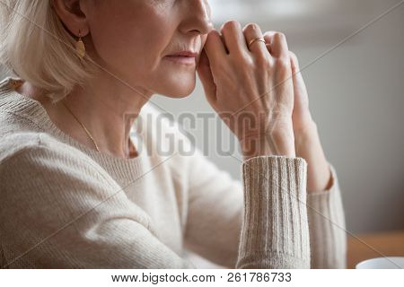 Close Up View Of Thoughtful Mature Woman Worried About Problems