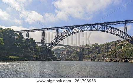 Maria Pia Bridge Over The Douro River, Porto, Portugal. Panoramic View From The Water. A Great Place
