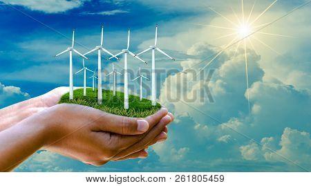 Wind Turbine Hand Alternative Energy Businessman Hand Holding Landscape With Eco Wind Turbine Concep