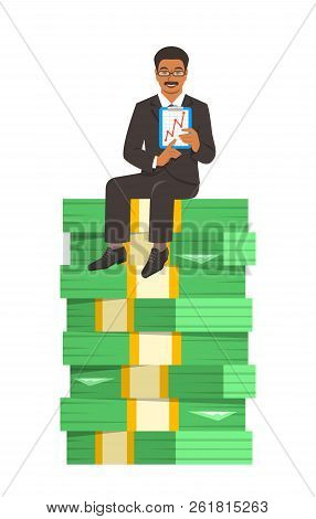 Black Businessman In Business Suit Sitting On A Top Of Stack Of Paper Money And Showing A Graph Of I