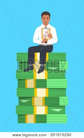 Black Businessman Sitting On A Top Of Stack Of Paper Money And Showing A Graph Of Income Growth. Fin