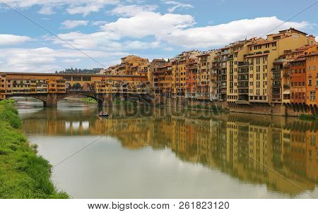 View Of Ponte Vecchio The Famous Arch Bridge Across Arno River In Florence (firenze), Tuscany, Italy