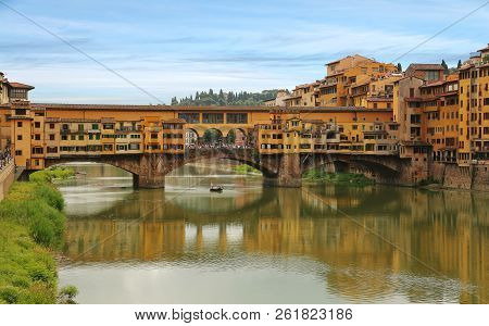 View Of Ponte Vecchio Bridge Across Arno River In Florence (firenze), Tuscany, Italy