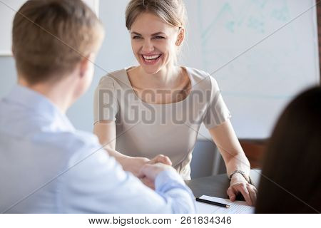 Happy Business Woman With Wide Smile Handshaking New Male Partne