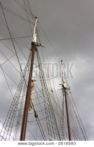 Cut mast on the gray sky. poster