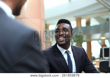 Business Meeting. African American Businessman Shaking Hands With Caucasian Businessman.