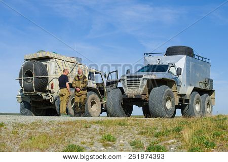 Yamal, Russia - August 22, 2018: Meeting On The Road. Two All-terrain Vehicles