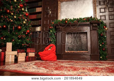 Beautiful Christmas Living Room With Decorated Christmas Tree, Gifts And Fireplace With The Glowing