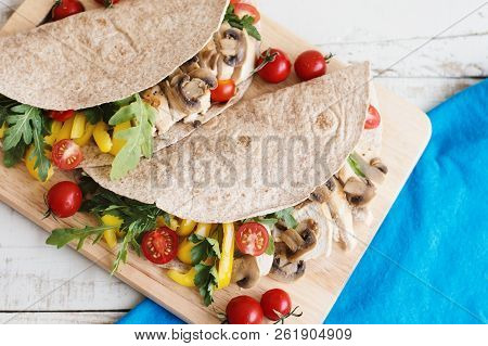 Two Whole Wheat Wraps With Chicken Breast, Mushrooms, Yellow Bell Pepper, Cherry Tomatoes, Arugula A