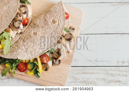 Healthy And Balanced Meal: Whole Wheat Wrap With Chicken Breast, Sliced Mushroom, Cherry Tomato, Yel
