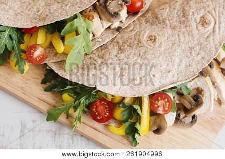 Chicken Wrap With Mushrooms, Cherry Tomatoes, Bell Pepper, Parsley And Arugula Leaves. Balanced Meal