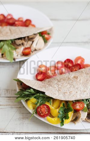 Healthy Whole Wheat Wrap With Chicken Breast, Mushroom, Cherry Tomatoes, Bell Pepper, Parsley And Ar