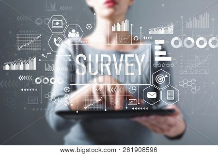 Survey With Business Woman Using A Tablet Computer