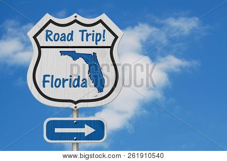 Florida Road Trip Highway Sign, Florida Map And Text Road Trip On A Highway Sign With Sky Background