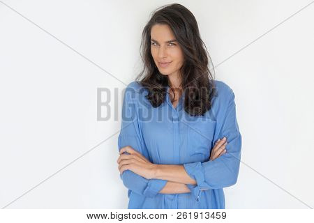 Brunette woman standing on white background, isolated
