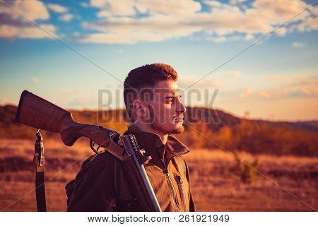 Autumn hunting season. Hunter with shotgun gun on hunt. Autunm hunting. Hunter Classic. Calibers of hunting rifles poster