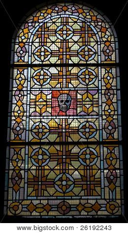 Skull themed stained glass window; Paris, France