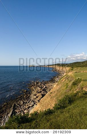 Rugged coastline and clear blue sky along Northern Cape Breton; NS, Canada