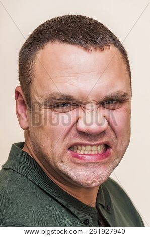 Human Face Can Be Different With Strong Expressions And Emotions. Mimicry Of Depressed, Angry Man On
