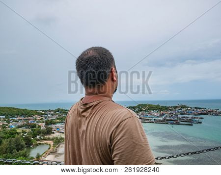 poster of Asisn Fat Traveler stand on top of  Khao Ma Jor Pier  with Idyllic ocean beautiful white cloud endless horizon and Fishman townscape in vacation time,chonburi thailand,holiday concept