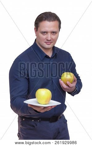 Portrait Of Young Athletic Elegant Man Offering One Apple On White Plate For You With One Hand And H