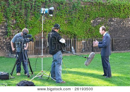 TV crew filming outside the British Parliament, I believe the presenter is the BBC's Andrew Marr