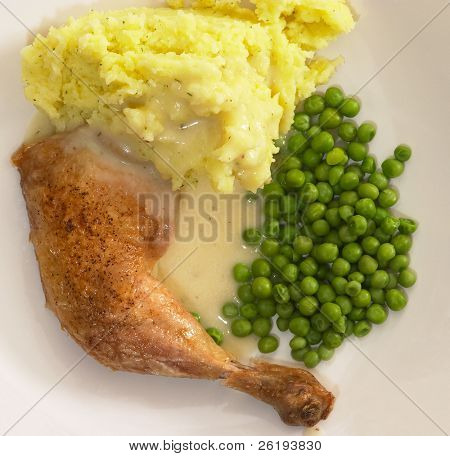 Grilled chicken dinner with parsley potatoes, peas and gravy