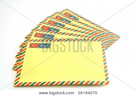 A group of unaddressed airmail envelopes waiting to be filled in.