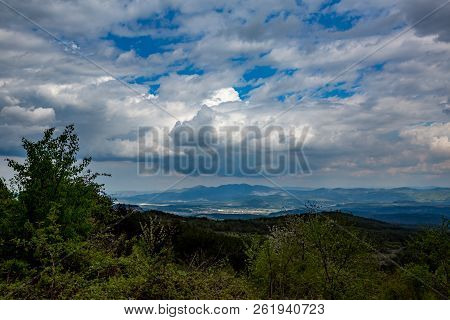 Beautiful Springtime Landscape Taken From Rhodope Mountain, Bulgaria. High Contrast Cloudy Sky With