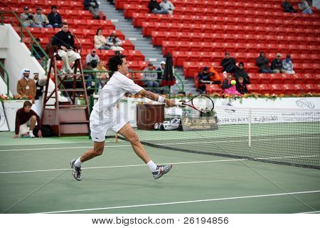 Younes El Aynoui of Morocco rushes the net in his Jan 2, 2007, Qatar Open first round win against Thomas Johansson of Sweden