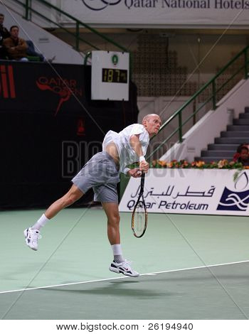 Nikolay Davydenko serving in the semi-final of the Qatar Open 2007, which he lost to Andy Murray, Jan 5, 2007.