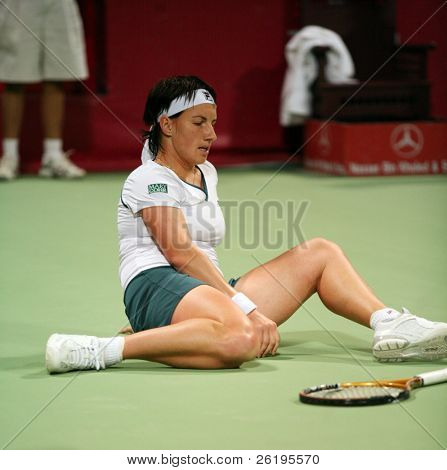 Russian tennis star Svetlana Kuznetsova, always battling to reach the hardest balls, recovers from a tumble during her match against Daniela Hantuchova, in Doha, March 2007