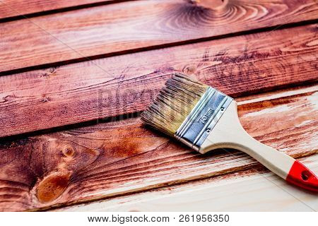 Varnishing A Wooden Shelf Using Paintbrush.brush And Paint, Stain, Wooden Floor, Wall, Repair, Resto